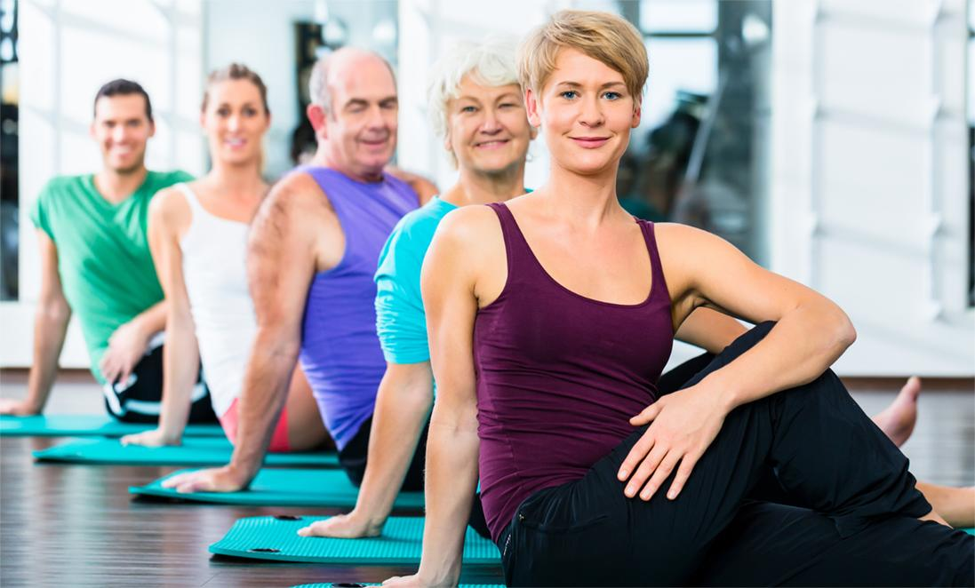 Image of people of all ages stretching in an exercise class